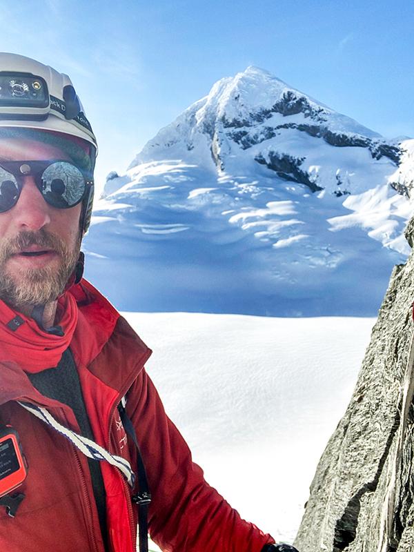 Josh climbing a snow peak.